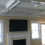 Custom coffered ceiling and fireplace surround