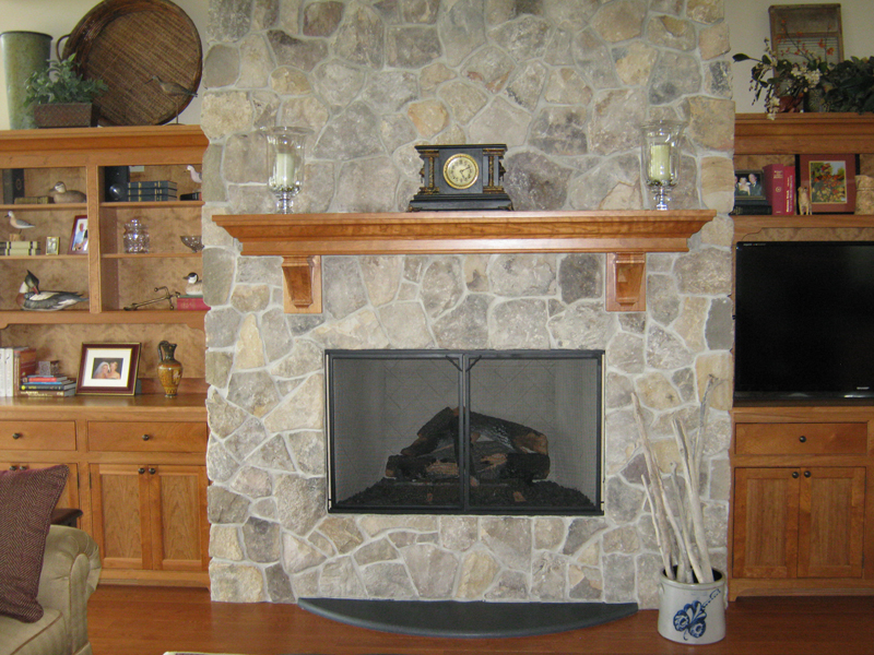 Custom stone fireplace with cherry mantle